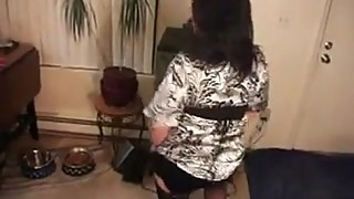 Housewife Wearing Stockings Dances Around