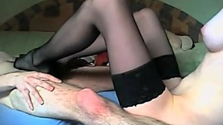 Babe wearing stocking and gives hubby footjob
