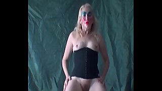 Blonde shows her tits and bush as she dances