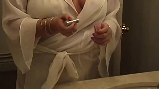Chubby wife in white lingerie uses big toys and makeup